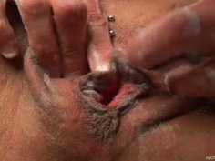 Mature slut Chelsea soaps her hairy cunt and fingers it