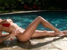 Bright busty babe Kayla Carrera masturbates near the pool