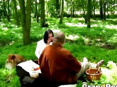 Slutty brunette teen in a steamy outdoor oral sex action with an horny older man