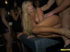 Fashionable babes gets fucked in the VIP