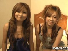 Two slutty Japanese chicks Yurina Shiho and Hibiki Mahiru gives a short interview before fucking one another