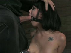 Tall and slim slave Asphyxia Noir gets attached to the wooden bar