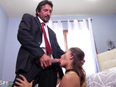 Brunette in stockings gives an old fart a passionate blowjob