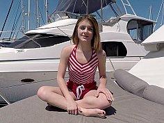 Slender teen sucks cock on a boat