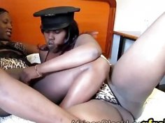 Big busy African lesbian sluts fingering and fucking their pussies with a dildo