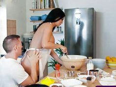 Busty chick beeing fucked while still cooking a cake