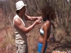 African slave gets mouth and cunt filled outdoors